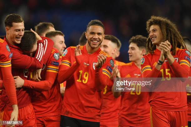 Tyler Roberts of Wales celebrates with Ethan Ampadu of Wales after the final whistle during the UEFA Euro 2020 qualifier between Wales and Hungary so...