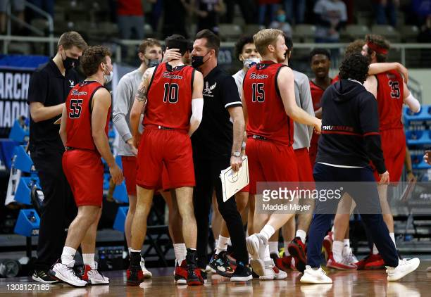 Tyler Robertson of the Eastern Washington Eagles and Jacob Davison of the Eastern Washington Eagles react with teammates on the sidelines during the...