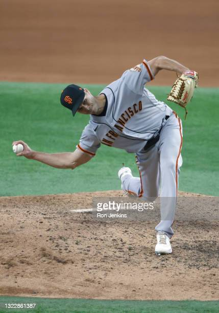 Tyler Rogers of the San Francisco Giants pitches against the Texas Rangers during the ninth inning at Globe Life Field on June 9, 2021 in Arlington,...