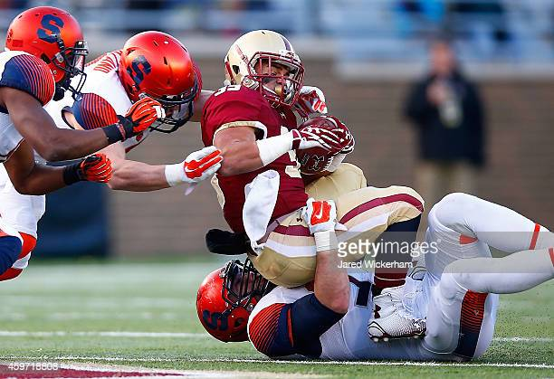 Tyler Rouse of the Boston College Eagles is tackled by Robert Welsh of the Syracuse Orangemen in the fourth quarter during the game at Alumni Stadium...