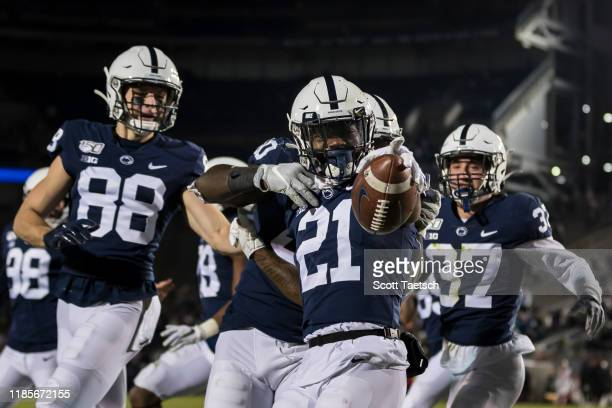 Tyler Rudolph of the Penn State Nittany Lions celebrates with teammates after recovering a kick against the Rutgers Scarlet Knights during the second...