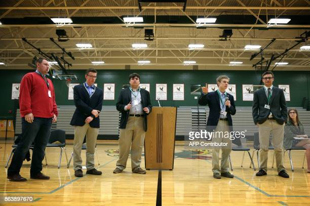Tyler Ruzich of Prairie Village Kansas flanked by Ethan Randleas of Wichita Jack Bergeson of Wichita and his running mate Lt Governor Candidate...