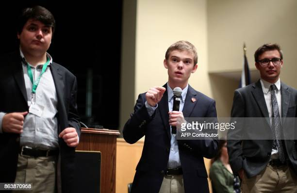 Tyler Ruzich of Prairie Village Kansas flanked by Jack Bergeson of Wichita and Dominic Scavuzzo of Leawood speaks during a forum with the three other...