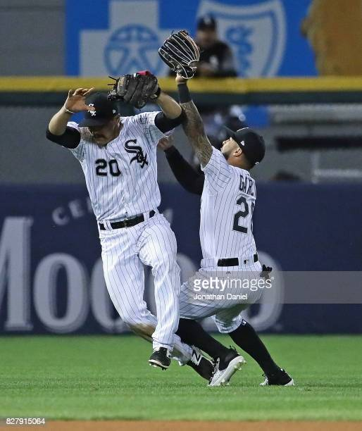 Tyler Saladino of and Leury Garcia of the Chicago White Sox collide after Saladino made a catch of a popup in the 6th inning against the Houston...
