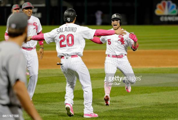 Tyler Saladino of the Chicago White Sox celebrates after scoring on a walk off RBI single by Yolmer Sanchez at Guaranteed Rate Field on May 13 2017...