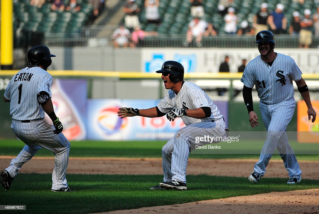 Tyler Saladino (C)of the Chicago White Sox celebrates his game winning single against the Seattle Mariners on August 30, 2015 at U.S. Cellular Field in Chicago, Illinois. The White Sox won 6-5 in eleven innings.