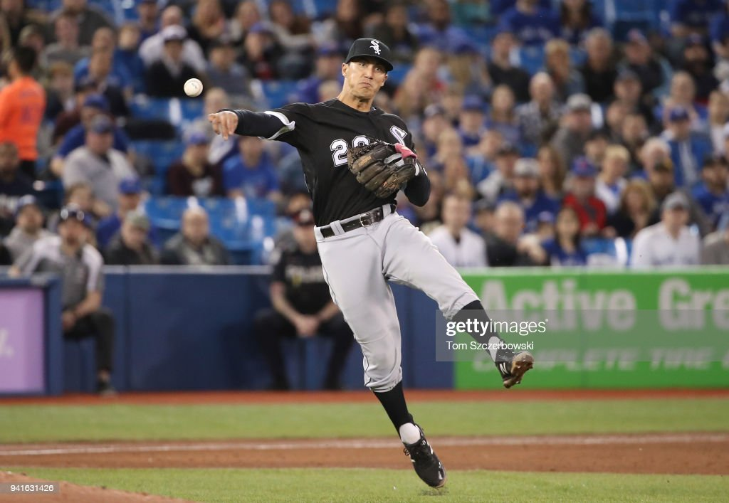 Tyler Saladino #20 of the Chicago White Sox makes the play and throws out the baserunner in the fifth inning during MLB game action against the Toronto Blue Jays at Rogers Centre on April 3, 2018 in Toronto, Canada.