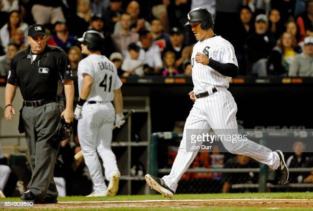 Tyler Saladino of the Chicago White Sox scores on a wild pitch thrown by Garrett Richards of the Los Angeles Angels of Anaheim during the fourth...