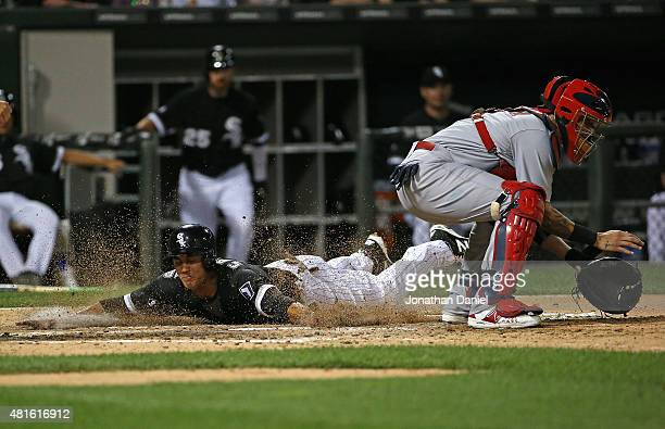 Tyler Saladino of the Chicago White Sox slides in to score a run in the 6th inning as Yadier Molina of the St Louis Cardinals awaits the throw at US...