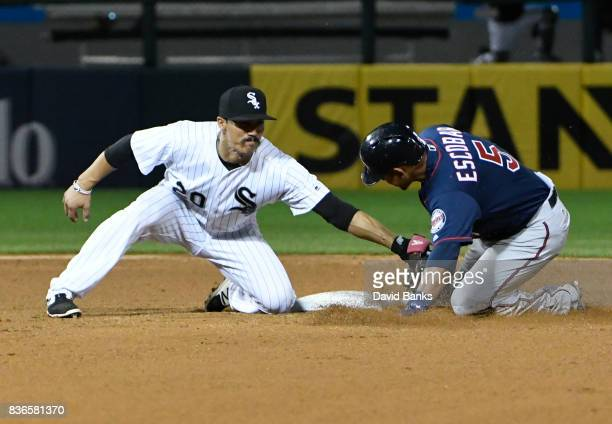 Tyler Saladino of the Chicago White Sox tags out Eduardo Escobar of the Minnesota Twins at second base during the fifth inning in game two of a...