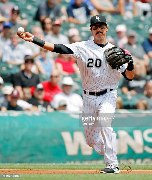 Tyler Saladino of the Chicago White Sox throws to first base for an out against the Toronto Blue Jays during the first inning at Guaranteed Rate...