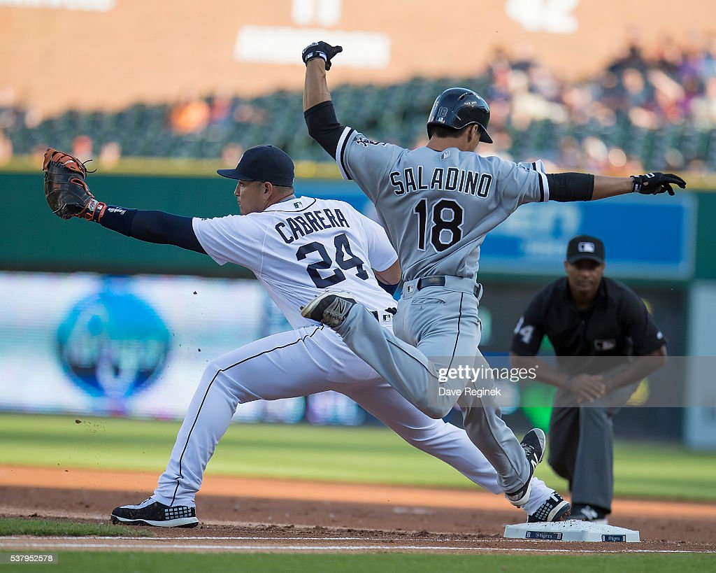 Tyler Saladino #18 of the Chicago White Sox tries to beat the throw to first baseman Miguel Cabrera #24 of the Detroit Tigers in the first inning during a MLB game at Comerica Park on June 3, 2016 in Detroit, Michigan.