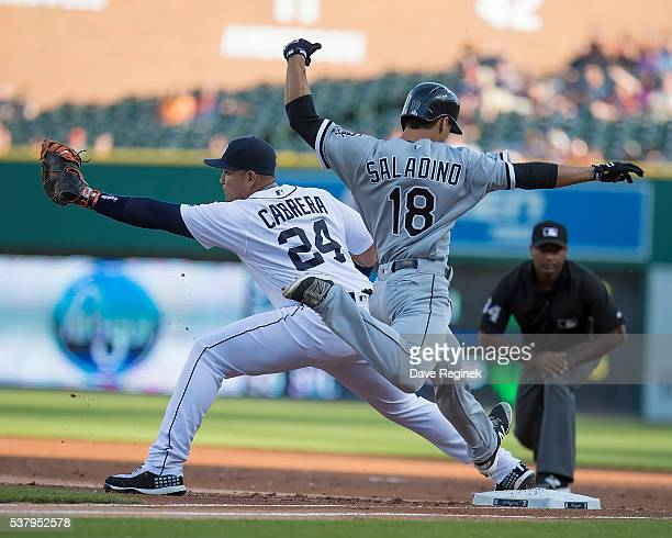Tyler Saladino of the Chicago White Sox tries to beat the throw to first baseman Miguel Cabrera of the Detroit Tigers in the first inning during a...