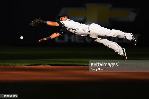 Tyler Saladino of the Milwaukee Brewers dives for a line drive during the first inning against the San Francisco Giants at Miller Park on July 13...