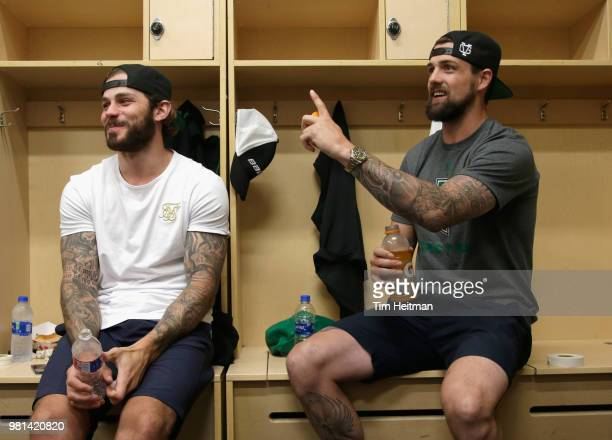 Tyler Seguin and Jamie Benn of the Dallas Stars talk in the locker room before the Community Ball Hockey Clinic with children from Big Brothers Big...