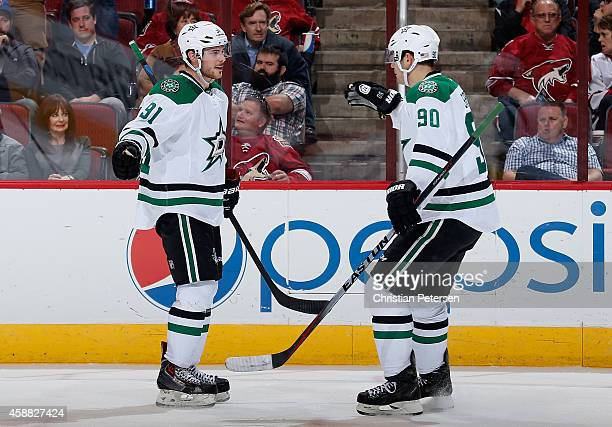 Tyler Seguin and Jason Spezza of the Dallas Stars celebrate after Seguin scored a second period goal against the Arizona Coyotes during the NHL game...