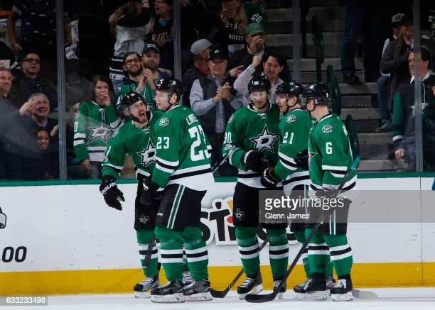 Tyler Seguin Jason Spezza Antoine Roussel Esa Lindell and Julius Honka of the Dallas Stars celebrate a goal against the Toronto Maple Leafs at the...