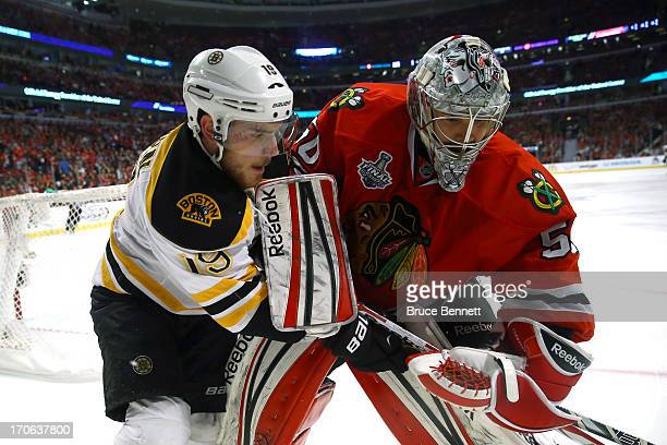 Tyler Seguin of the Boston Bruins and goalie Corey Crawford of the Chicago Blackhawks get their sticks tied up in Game Two of the NHL 2013 Stanley...