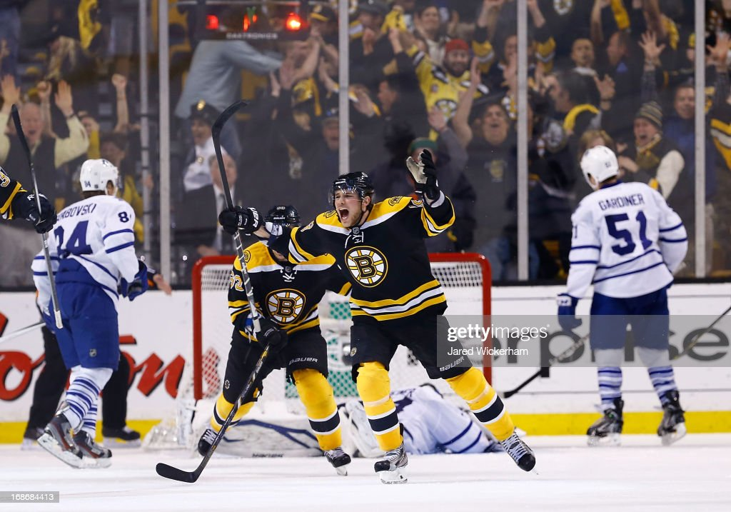 Tyler Seguin #19 of the Boston Bruins celebrates following teammate Patrice Bergeron's #37 of the Boston Bruins game-winning goal in overtime against the Toronto Maple Leafs in Game Seven of the Eastern Conference Quarterfinals during the 2013 NHL Stanley Cup Playoffs on May 13, 2013 at TD Garden in Boston, Massachusetts.