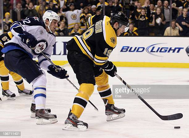 Tyler Seguin of the Boston Bruins heads for the net to score the game winner as Randy Jones of the Winnipeg Jets defends on January 10 2012 at TD...