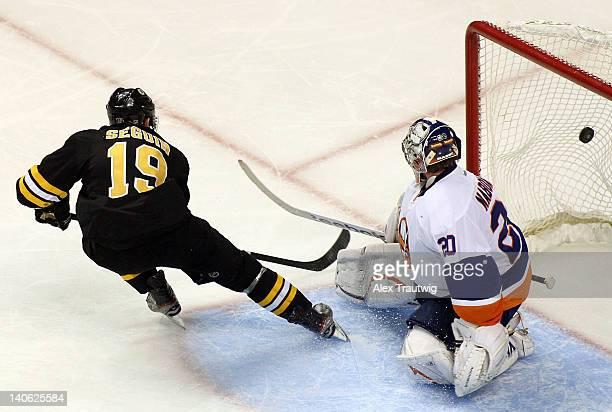 Tyler Seguin of the Boston Bruins scores a goal against Evgeni Nabokov of the New York Islanders at TD Garden on March 3, 2012 in Boston,...