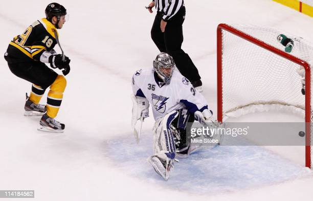Tyler Seguin of the Boston Bruins scores a goal past Dwayne Roloson of the Tampa Bay Lightning in the first period of Game One of the Eastern...