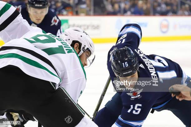 Tyler Seguin of the Dallas Stars and Matt Hendricks of the Winnipeg Jets get set for a first period faceoff at the Bell MTS Place on November 2 2017...