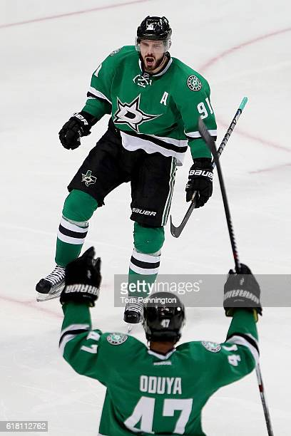 Tyler Seguin of the Dallas Stars celebrates with Johnny Oduya of the Dallas Stars after scoring against the Winnipeg Jets in the third period at...