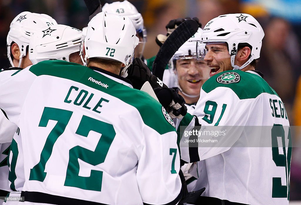 Tyler Seguin #91 of the Dallas Stars celebrates with teammates following their shootout win against the Boston Bruins at TD Garden on November 5, 2013 in Boston, Massachusetts.