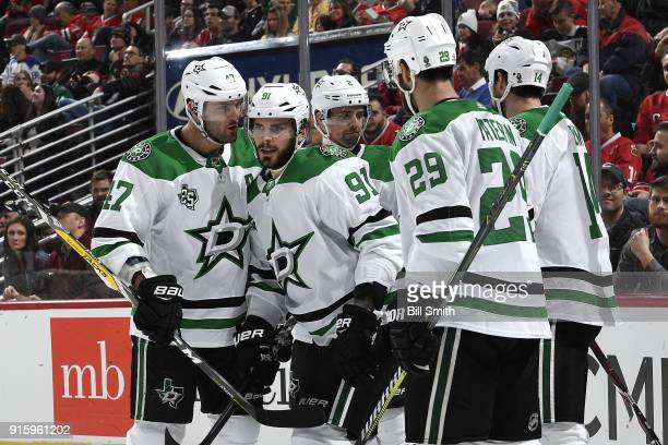 Tyler Seguin of the Dallas Stars celebrates with teammates including Alexander Radulov after scoring against the Chicago Blackhawks in the second...