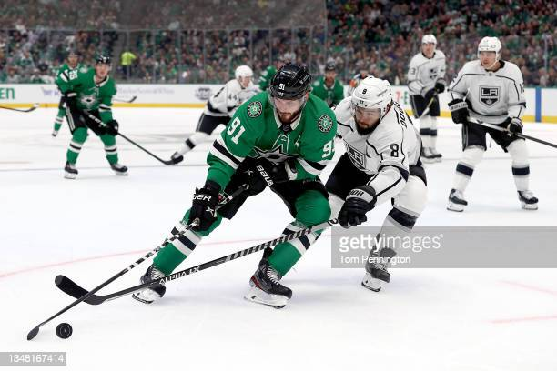 Tyler Seguin of the Dallas Stars controls the puck against Drew Doughty of the Los Angeles Kings in the first period at American Airlines Center on...