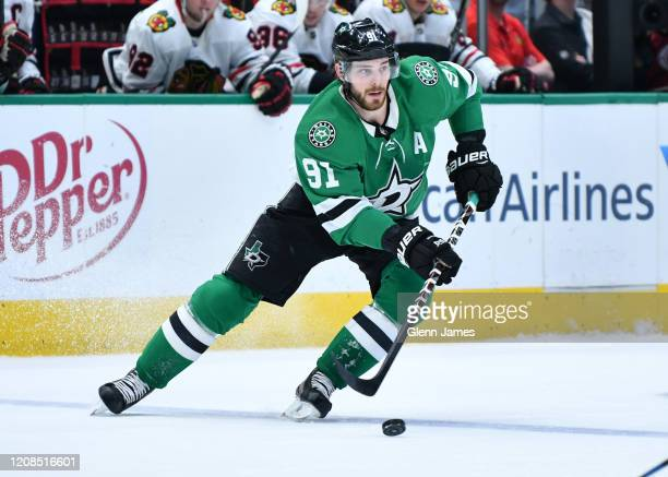 Tyler Seguin of the Dallas Stars handles the puck against the Chicago Blackhawks at the American Airlines Center on February 23, 2020 in Dallas,...