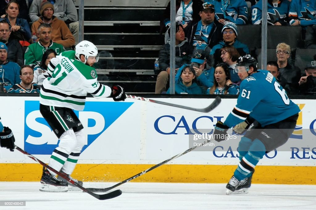 Tyler Seguin #91 of the Dallas Stars passes the puck by Justin Braun #61 of the San Jose Sharks at SAP Center on February 18, 2018 in San Jose, California.