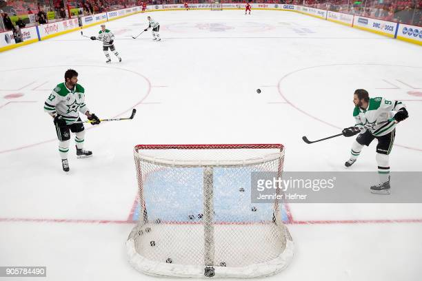 Tyler Seguin of the Dallas Stars passes the puck to teammate Alexander Radulov during warmups prior to an NHL game against the Detroit Red Wings at...