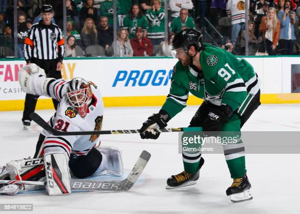 Tyler Seguin of the Dallas Stars scores a shootout goal against Anton Forsberg of the Chicago Blackhawks at the American Airlines Center on December...