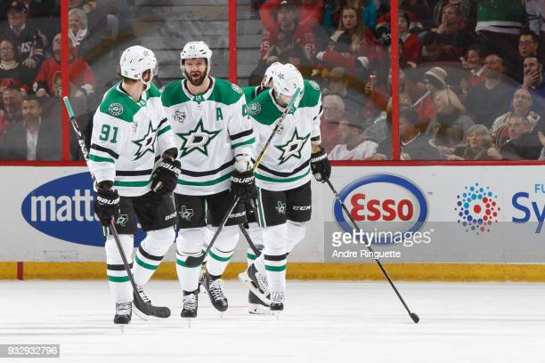 Tyler Seguin of the Dallas Stars shares a smile with teammates Alexander Radulov and John Klingberg after his first period goal against the Ottawa...