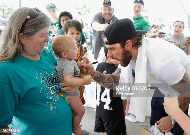 Tyler Seguin of the Dallas Stars signs autographs after the Community Ball Hockey Clinic with children from Big Brothers Big Sisters of Greater...