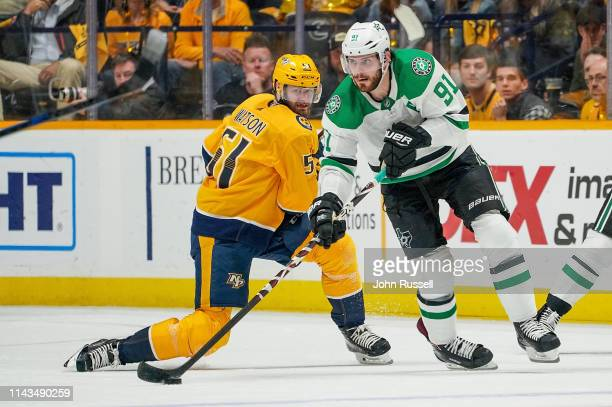 Tyler Seguin of the Dallas Stars skates against Austin Watson of the Nashville Predators in Game Two of the Western Conference First Round during the...