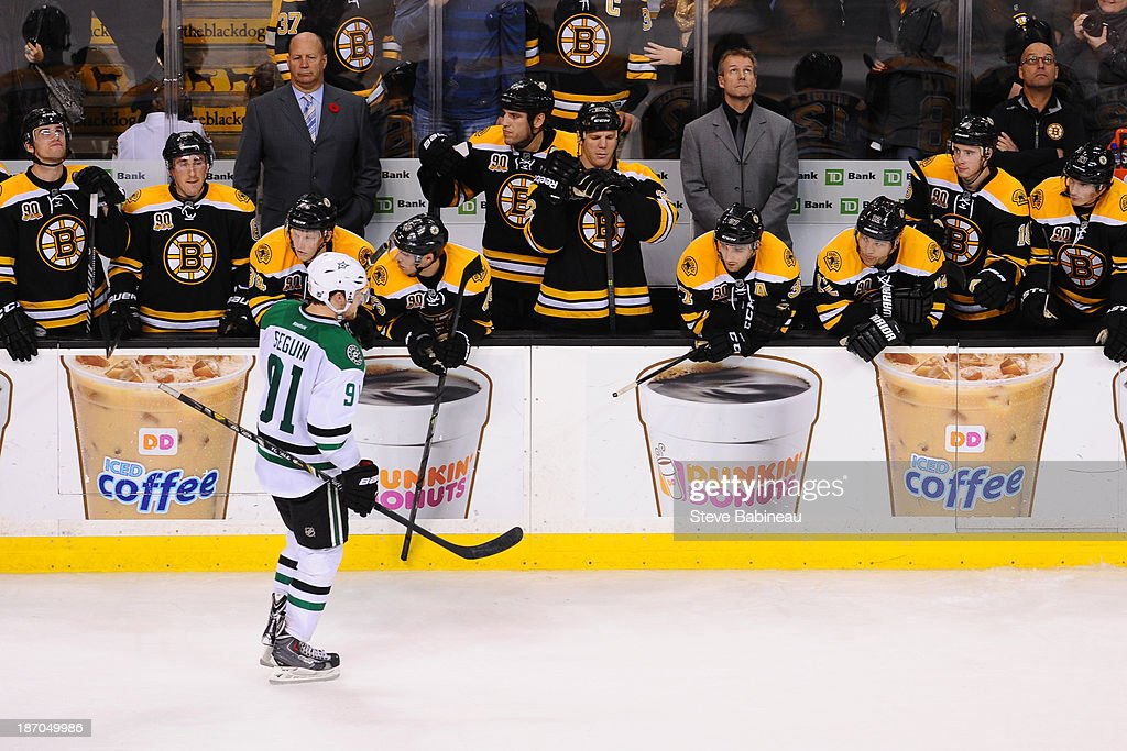Tyler Seguin #91 of the Dallas Stars skates by the bench of the Boston Bruins after scoring in a shoot out at the TD Garden on November 5, 2013 in Boston, Massachusetts.