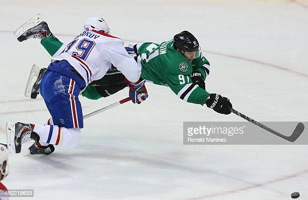 Tyler Seguin of the Dallas Stars takes a shot on goal while defended by Andrei Markov of the Montreal Canadiens in the second period at American...