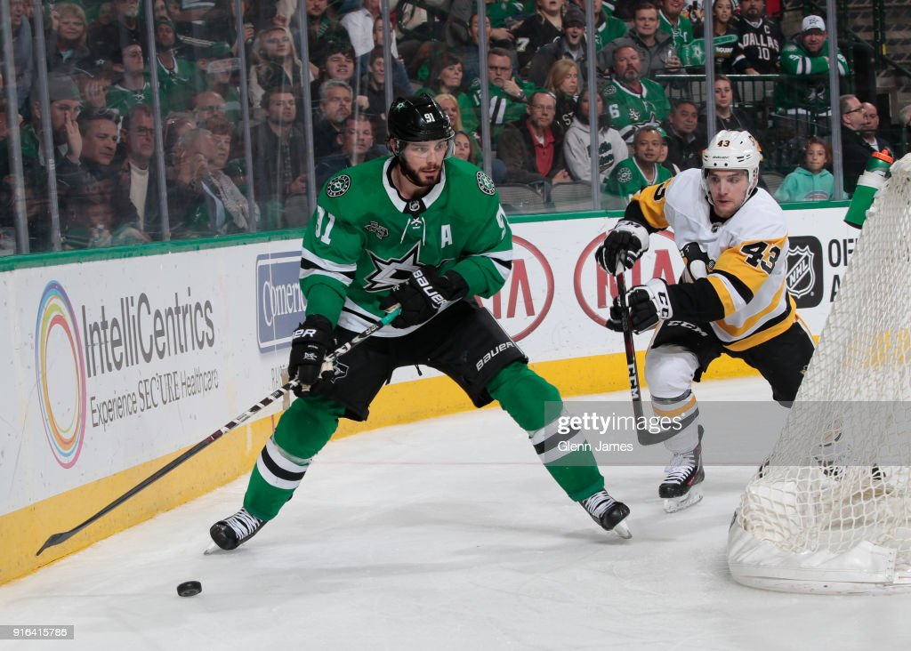 Tyler Seguin #91 of the Dallas Stars tries to keep the puck away against the Pittsburgh Penguins at the American Airlines Center on February 9, 2018 in Dallas, Texas.