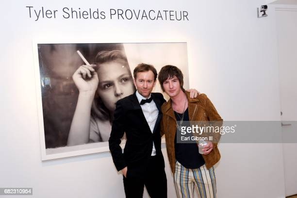 Tyler Shields and actor Andrew James Allen attend Tyler Shields 'Provocateur' Opening at Leica Store and Gallery Los Angeles on May 11 2017 in Los...