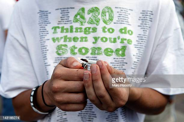 Tyler Shumway of Aurora Colorado lights up a joint as thousands gathered to celebrate the state's medicinal marijuana laws and collectively light up...