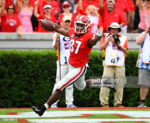 Tyler Simmons of the Georgia Bulldogs celebrates after scoring a touchdown on a 56 yard carry against the Middle Tennessee Blue Raiders on September...