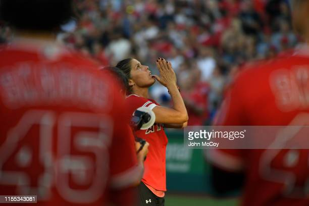 Tyler Skaggs mother Debbie Hetman looks up to the sky after throwing out the first pitch before the Los Angeles Angels of Anaheim faced the Seattle...