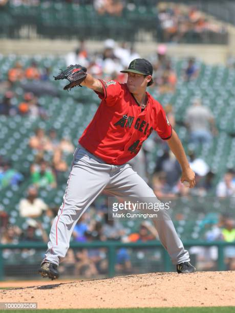 Tyler Skaggs of the Los Angeles Angels of Anaheim pitches while wearing a special jersey hat and shoes to honor Memorial Day during the game against...