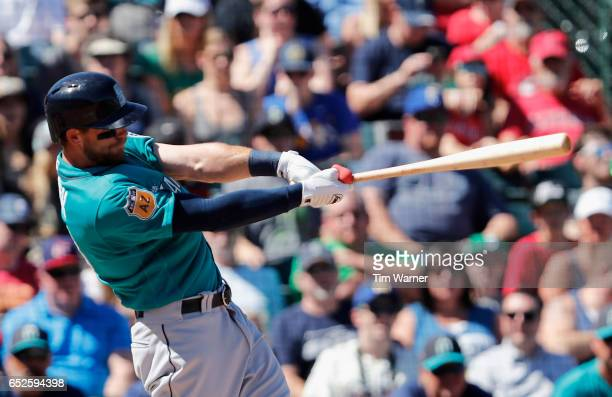 Tyler Smith of the Seattle Mariners hits a home run in the second inning against the Los Angeles Angels of Anaheim during a spring training game at...