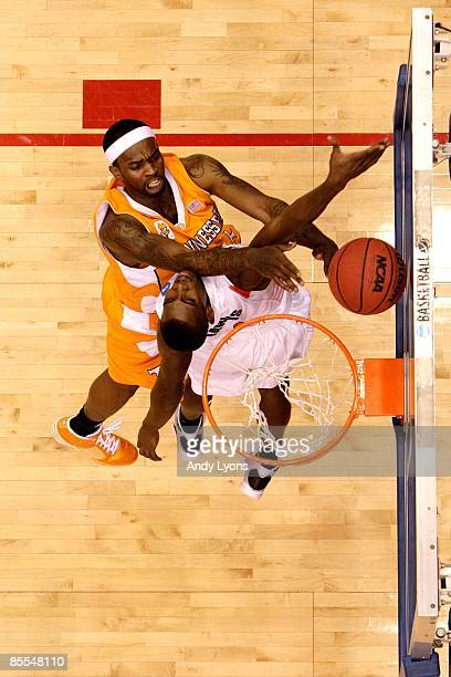 Tyler Smith of the Tennessee Volunteers drives to the hoop against James Anderson of the Oklahoma State Cowboys during the first round of the NCAA...