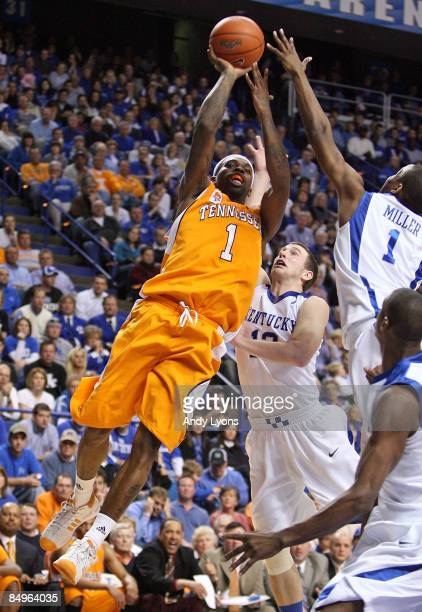 Tyler Smith of the Tennessee Volunteers shoots the balll over Darius Miller of the Kentucky Wildcats during the SEC game at Rupp Arena on February...