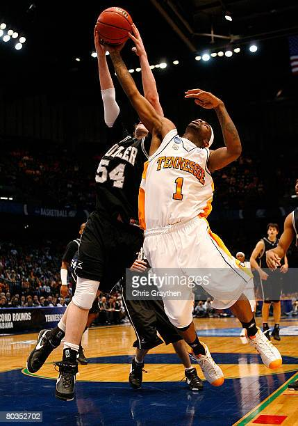 Tyler Smith of the Tennessee Volunteers tries to block the shot of Matt Howard of the Butler Bulldogs during the second round of the East Regional as...